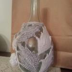 Coprifiasco in cotone e filo argentato lavorato a crochet