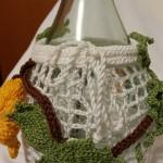Paricolare coprifiasco con Vite, lavorati a mano, crochet e tricotin